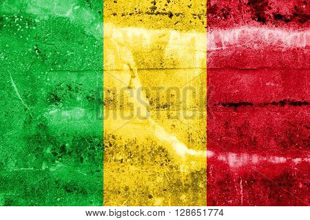 Mali Flag painted on grunge wall. Vintage and old look.