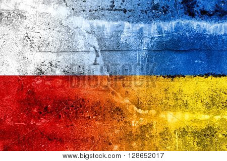 Poland And Ukraine Flag Painted On Grunge Wall