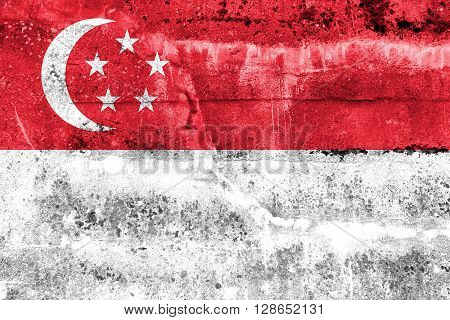 Singapore Flag painted on grunge wall. Vintage and old look