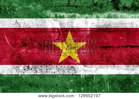 Suriname Flag painted on grunge wall. Vintage and old look