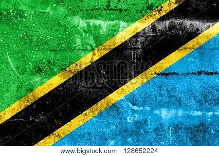 Tanzania Flag painted on grunge wall. Vintage and old look