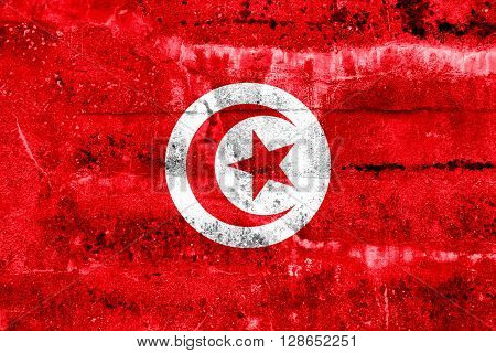 Tunisia Flag painted on grunge wall. Vintage and old look.