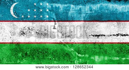 Uzbekistan Flag painted on grunge wall. Vintage and old look