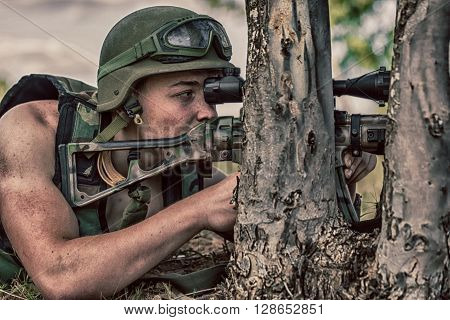 young a soldier in the uniform with weapon.** Note: Soft Focus at 100%, best at smaller sizes