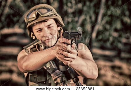 young a soldier in the uniform with weapon. ** Note: Soft Focus at 100%, best at smaller sizes