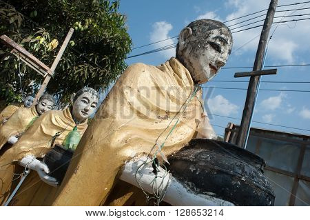 Sculptural group of Buddhist monks in the center of Kawthaung town in the south of Myanmar