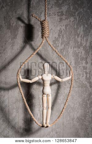Wooden Figure Of Human In A Hangmans Loop
