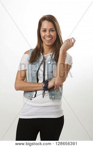 twenty something girl wearing a jean sleeveless jacket