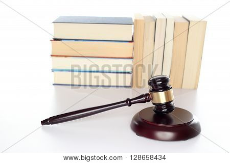 documents and gavel on a white desk