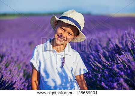 Happy baby boy in lavender summer field near Valensole. Provence, France.
