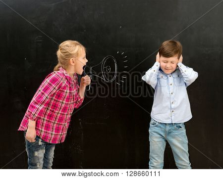 little girl shouting in drawn on the blackboard mouthpiece and little boy covering his ears with his hands