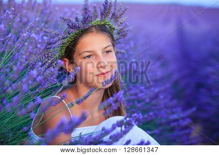 Portrait of beautiful young girl in the lavander fields in Valensole. Provence, France.