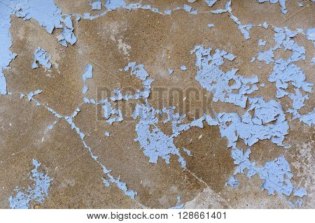 Concrete blue cracked wall as a grunge background