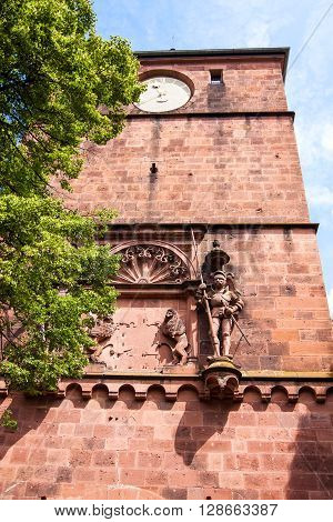 Antique sculpture of a knight and a wall fragment of Heidelberg castle Germany