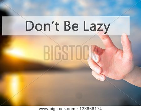 Don't Be Lazy - Hand Pressing A Button On Blurred Background Concept On Visual Screen.