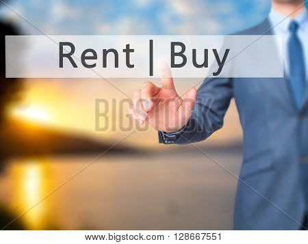 Rent Buy - Businessman Hand Pressing Button On Touch Screen Interface.