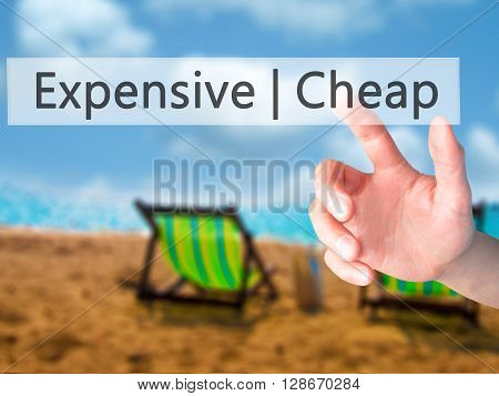 Expensive  Cheap - Hand Pressing A Button On Blurred Background Concept On Visual Screen.