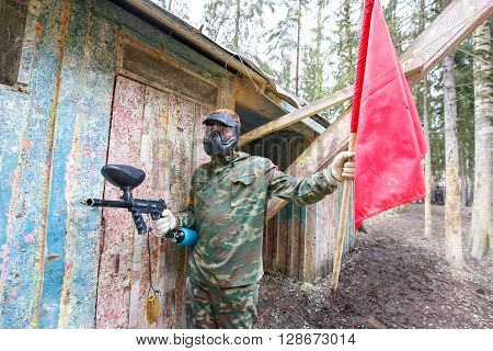 Saint-Petersburg, Russia - April 24, 2016: Paintball tournament in Snaker club between student teams from five universities. Player with red flag.