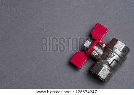 Water Valve With Red Handle On Grey