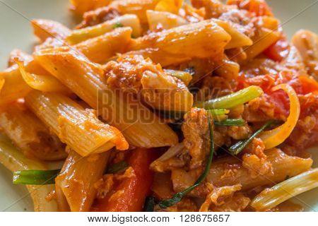 Macaroni and tomato sauce , meal - time