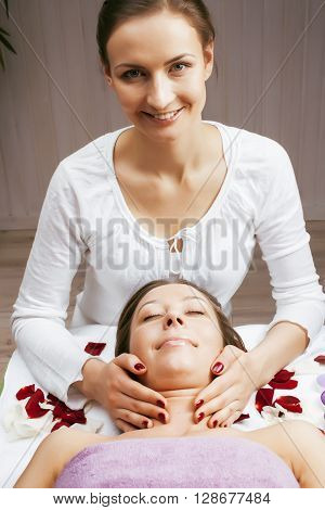 stock photo attractive lady getting spa treatment in salon, massage doctor smiling care pretty cure