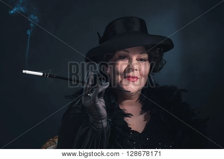 Retro Woman Wearing Hat And Smoking Cigarette. 1930S Classic Portrait.