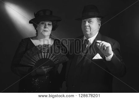 Vintage Well Dressed 1940S Couple With Fan And Cigar. Black And White Classic Portrait.