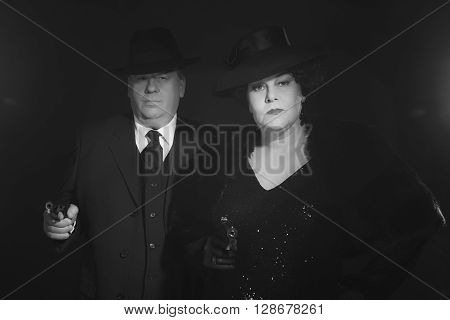 Retro 1940S Gangster Couple. Black And White Classic Portrait.