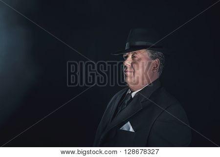 Vintage 1930S Gangster Wearing Hat. Classic Studio Portrait.