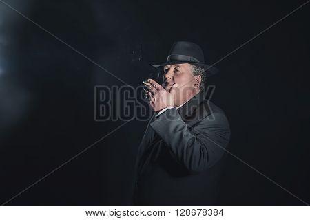 Retro 1940S Gangster Smoking Cigar. Classic Studio Portrait.