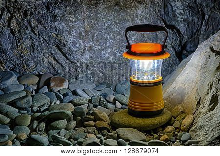 Luminous hand lantern standing on pebble near bouldeers HDR processing ** Note: Soft Focus at 100%, best at smaller sizes