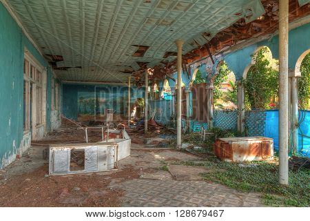 Interior of an abandoned dilapidated restaurant