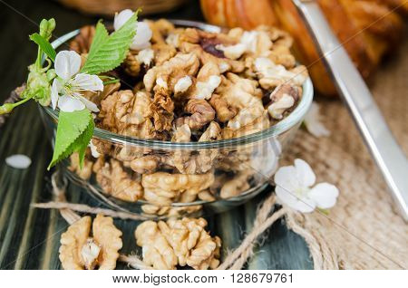 peeled walnuts in a glass bowl close-up
