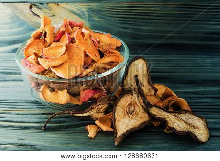 still life of fruit and dried fruits on wooden background