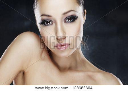 Portrait of a beautiful woman on grey backround studio shot