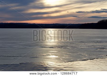 Photo of a beautiful sunset on the icy lake