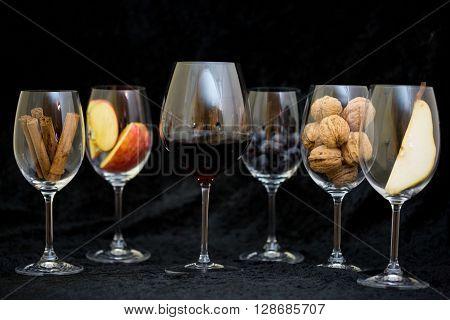 wine tasting, wine glas with apple, walnut, Cinnamon and pear