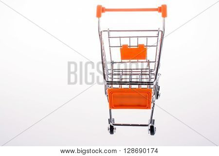 A shopping cart in a white background