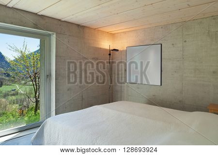 Interior of a modern chalet in cement, bedroom