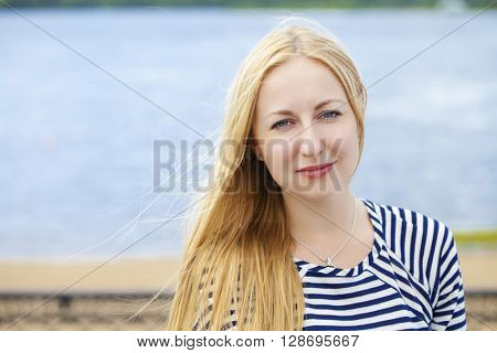 Portrait close up of young beautiful woman, on green background summer nature