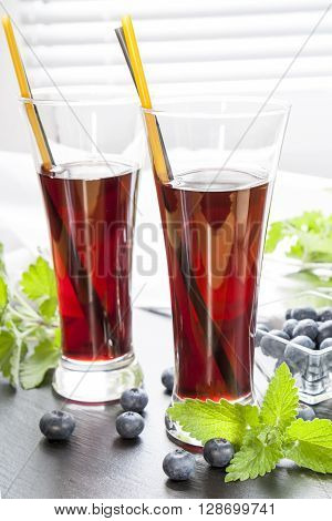 Glasses With Fresh Black Currant Juice. Bog Blueberry And Lemon Balm