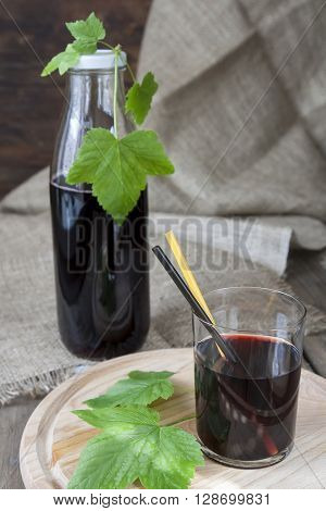 Glass And Bottle With Fresh Black Currant Juice Decoration Fresh Currant Leaves