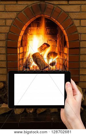 Man Photographs Fireplace On Tablet Pc