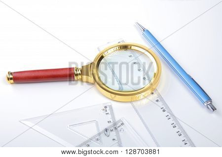pair of compasses drawing circle on a paper. ** Note: Shallow depth of field