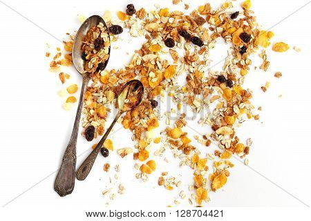 Delicious Granola Muesli Cereal With Two Vintage Spoons On White Background, Healthy Eating Concept