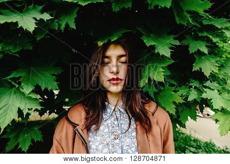 Beautiful Brunette Woman Standing Under Amazing Green Tree Crown In City Park In Sunny Springtime, E