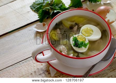Soup Of Young Nettle With Eggs, Selective Focus. Space For Your Text.