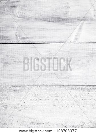 The white rustic planked wooden background. Horizontal planks.