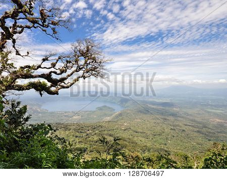 Hazy landscape of the volcanic caldera Lake Coatepeque in Salvador seen from the Cerro Verde National Park
