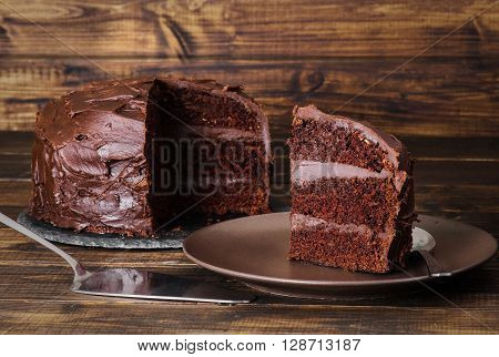 Chocolate food devil's cake on dark wooden background captured in low key formate